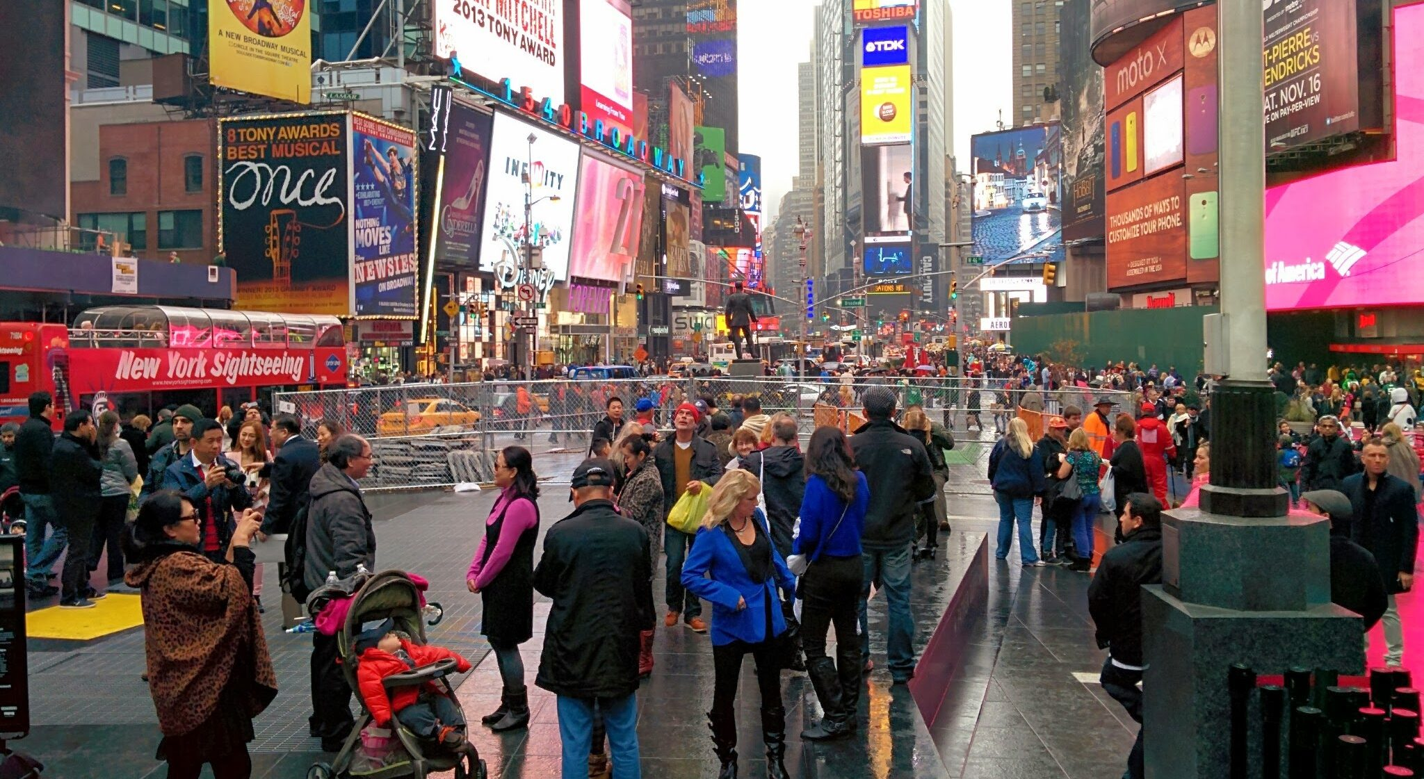 Technical Penguins: A photo of Times Square in NYC shows a lot of billboards and people milling around.