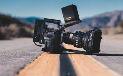 Technical Penguins: How and where to find the best free images for your website project. A camera with a large lens and flash is seen sitting in the middle of a highway on the double yellow line.